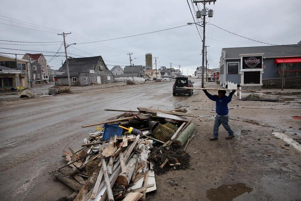 Chico Tomas worked on clearing debris at Venus II Restaurant & Sport Bar in Marshfield.